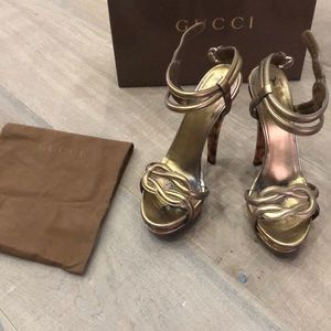 Gucci heels with tortoise colored heel